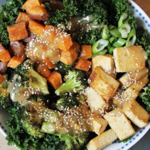 Sesame kale, roasted sweet potato, broccoli & tofu buddha bowl with a peanut sauce