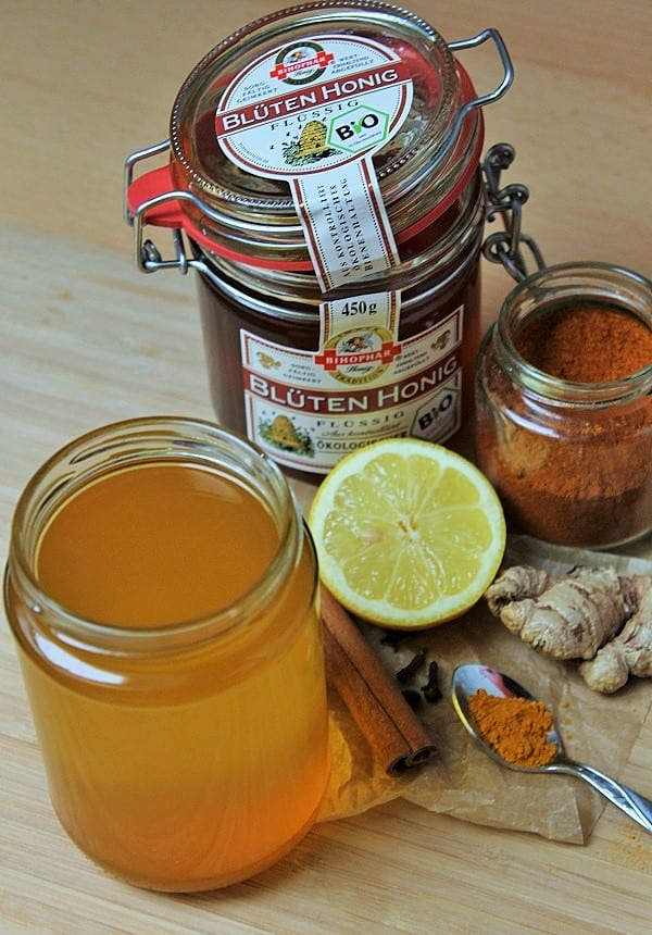 Homemade infusion to fight the flu with raw honey, lemon, ginger, cinnamon, turmeric and Cayenne