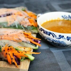 Crunchy spring rolls with a spicy coconut and red curry peanut sauce