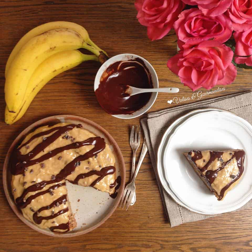 Healthy banana cake with peanut butter frosting and raw maca chocolate sauce