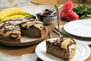 Healthy banana cake with peanut butter frosting and raw cacao and maca sauce