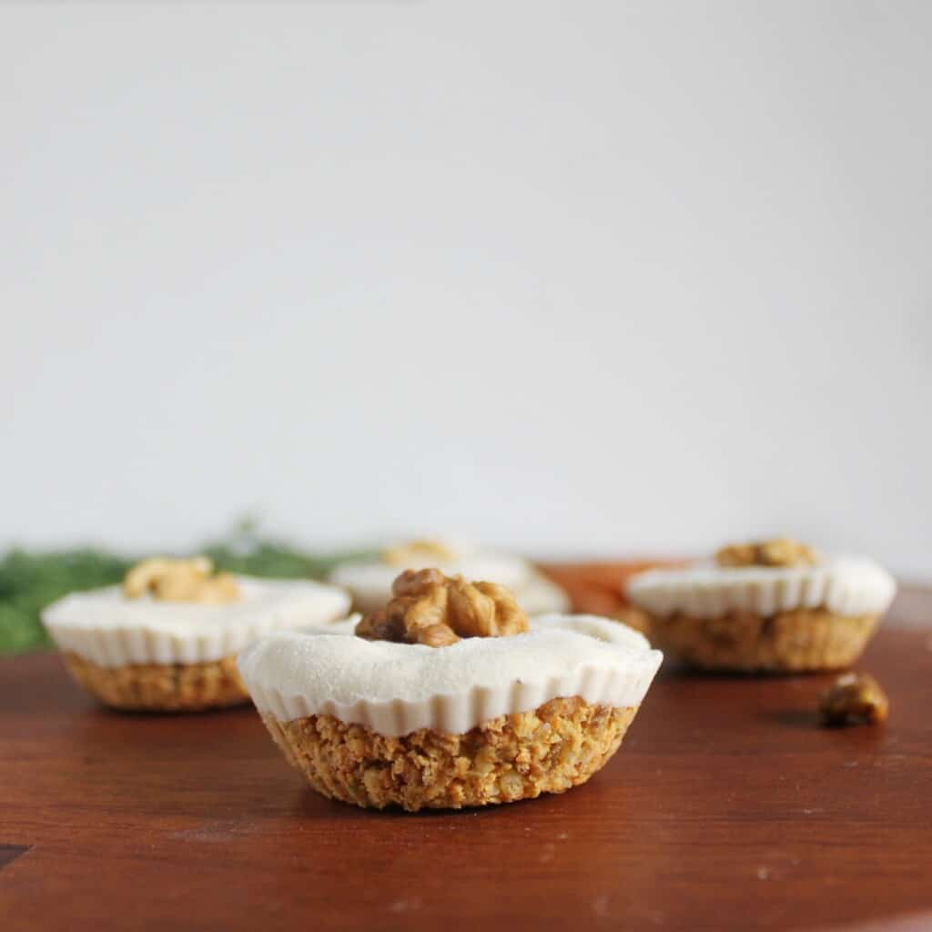 Raw carrot cupcakes with a vegan cheesecake layer