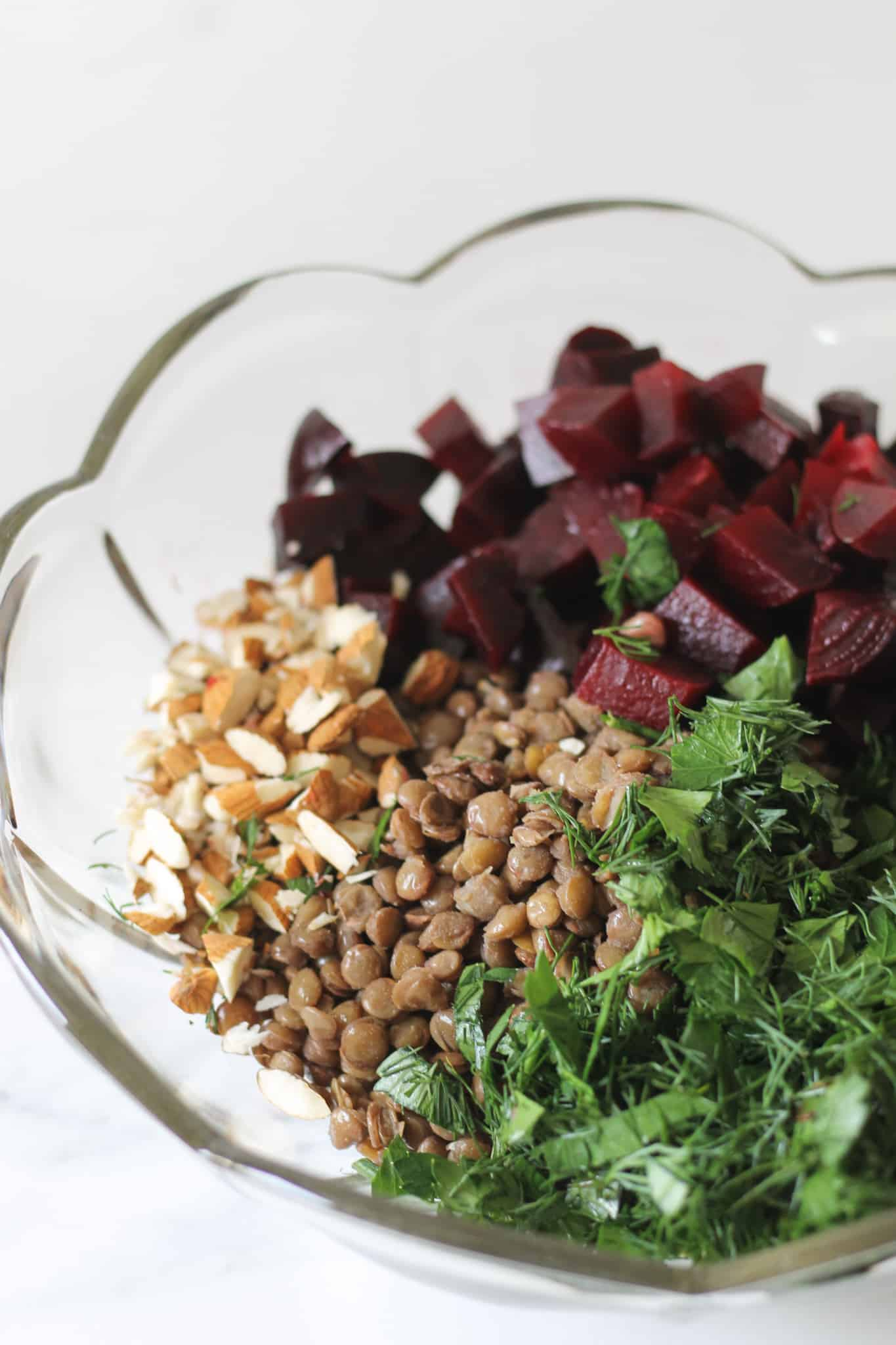 Lentil and beetroot salad ingredients in a glass bowl