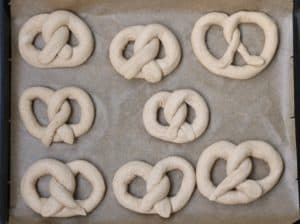 vegan pretzels on a baking sheet with parchment paper