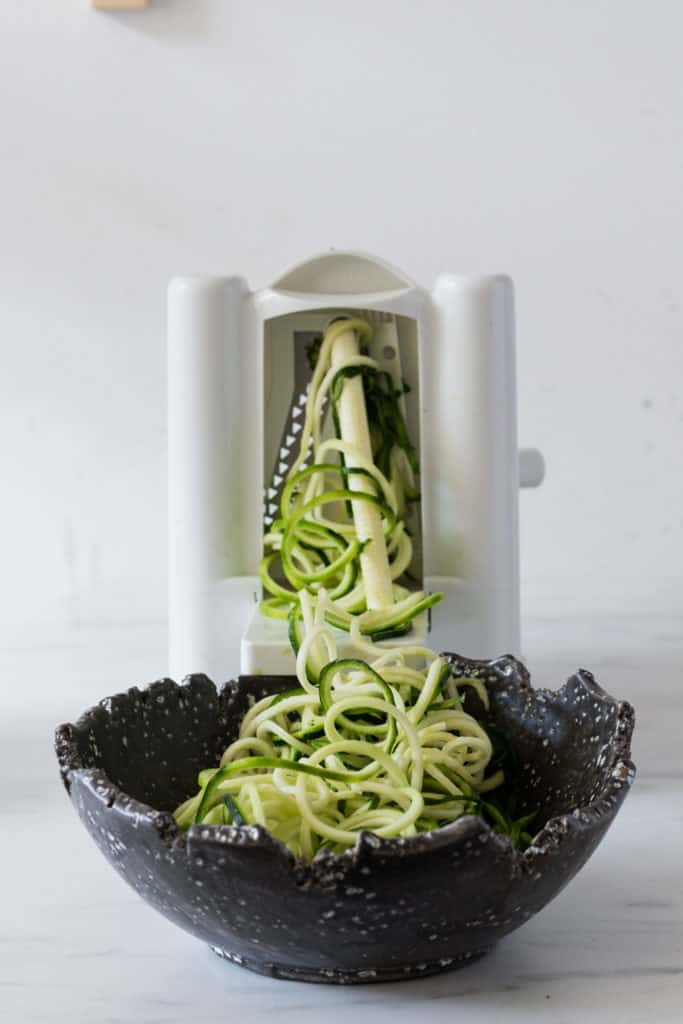 zoodles coming out of the spiralizer