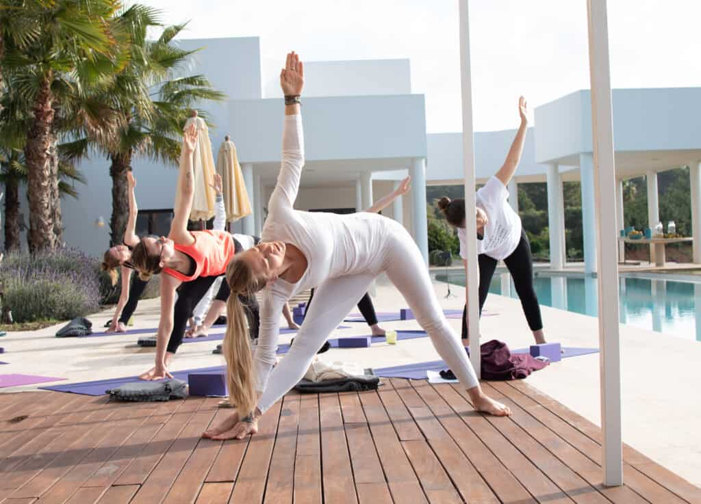 Yoga by the pool in Ibiza