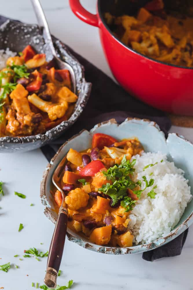 vegan sweet potato curry in two bowls with rice